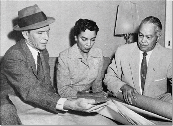 Frank Sinatra goes over plans for his home with architect Paul R. Williams and Williams' daughter, interior decorator Norma Harvey