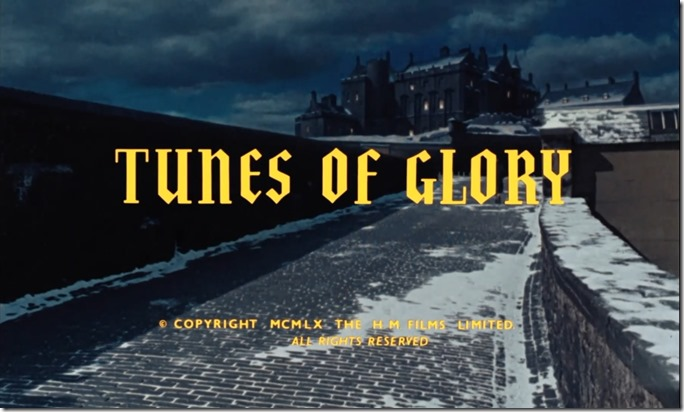 Tunes of Glory. At night, a snowy brick road leading to an elaborate Scottish fort on a distant hill