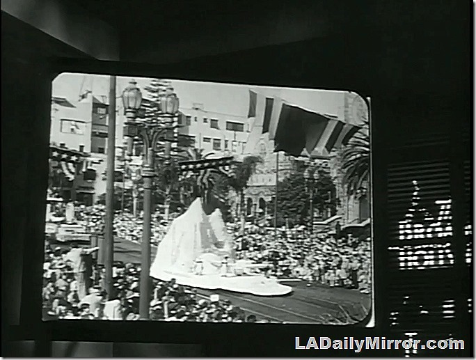 Rose Parade, The Brasher Doubloon. Newsreel footage of a float next to window showing the Broadway Hollywood sign